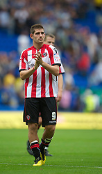 CARDIFF, WALES - Sunday, August 8, 2010: Sheffield United's goalscorer Ched Evans applauds the supporters after the 1-1 League Championship draw with Cardiff City at the Cardiff City Stadium. (Pic by: David Rawcliffe/Propaganda)