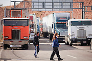 19 DECEMBER 2008 -- NOGALES, SON, MEX: Pedestrians walk through the line of trucks waiting to enter the US on the Mexican side of the Mariposa port of Entry in Nogales.    PHOTO BY JACK KURTZ