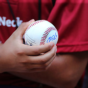 NEW YORK, NEW YORK - July 17: A young fan waits for autographs on his baseball at the New York Yankees batting practice before the Boston Red Sox Vs New York Yankees regular season MLB game at Yankee Stadium on July 17, 2016 in New York City. (Photo by Tim Clayton/Corbis via Getty Images)