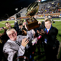 Thomas Wells | Buy at PHOTOS.DJOURNAL.COM<br /> Starkville head coach Ricky Woods gets the trophy for winning Friday's class 6A State Championship over Petal.