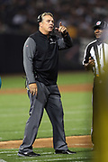 Oakland Raiders head coach Jack Del Rio points toward the replay on the scoreboard as he complains to an official about a nullified third quarter Raiders touchdown during the 2017 NFL week 4 preseason football game against the Seattle Seahawks, Thursday, Aug. 31, 2017 in Oakland, Calif. The Seahawks won the game 17-13. (©Paul Anthony Spinelli)