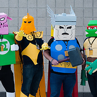 London, UK - 15 March 2014: people dressed as teenage mutant ninja turtle, Thor, Doctor Fate and Kilowog pose for a picture during the London Super Comic Con at Excel.