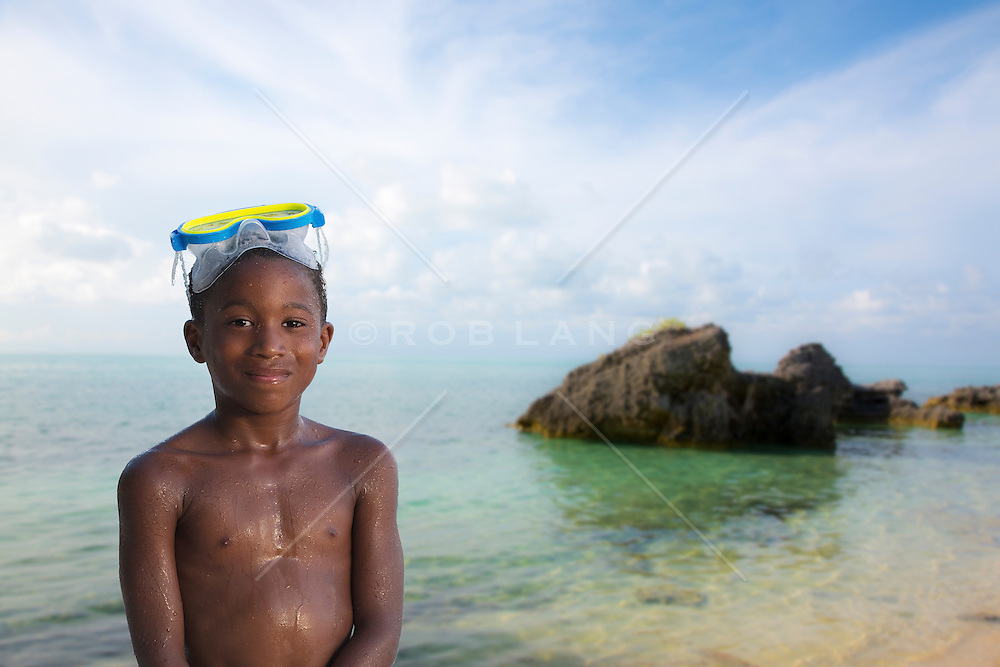 African American boy at the beach in Bermuda with a diving mask on his head