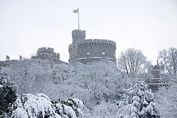 © under license to London News Pictures.  18/12/2010 A snow covered Windsor Castle as seen from Datchet Road.  The Union Flag shows the Queen was not in residence.  Picture credit should read Ed Brown/London News Pictures
