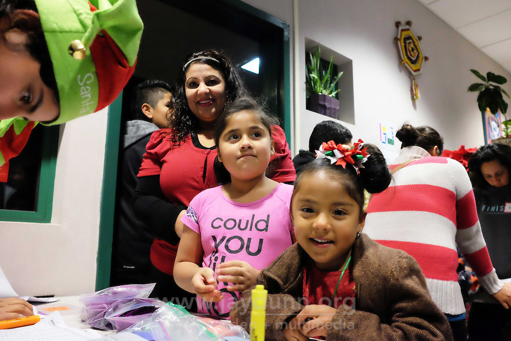 Kids check in at the Alisal Family Resource Center on Friday, host to the third annual César Chávez Futból Academy toy drive.