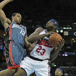 10 December 2008:  New Orleans Hornets guard Devin Brown (23) is defended by Charlotte Bobcats guard Shannon Brown (12) on a shot during a NBA regular season game between the Charlotte Bobcats and the New Orleans Hornets at the New Orleans Arena in New Orleans, LA. The game was an NBA Hardwood Classic with the Hornets dressed out in throwback uniforms honoring the former ABA franchise the New Orleans Buccaneers..