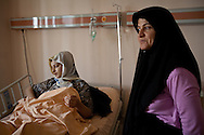 A young Syrian girl lays in hospital in Antakya, Turkey, with her mother. Whilst fleeing towards the Syrian border her group of refugees reportedly camp under attack by the Syrian military near Lattakia, Syria.
