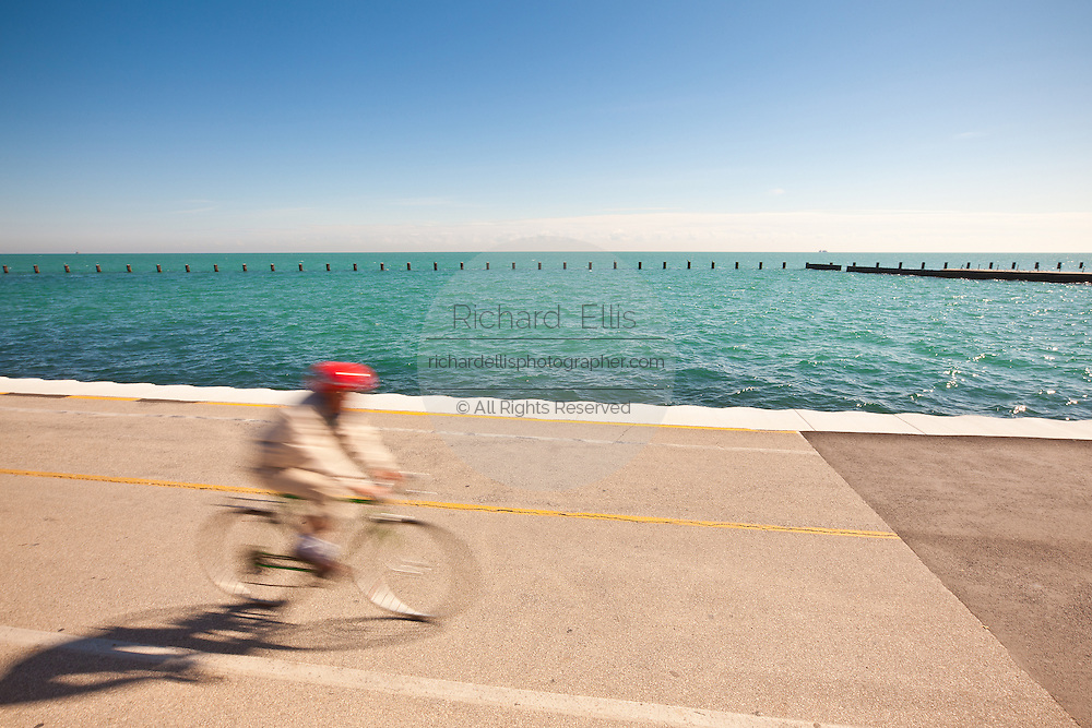 A bicyclist rides along Lake Michigan in downtown Chicago, IL.