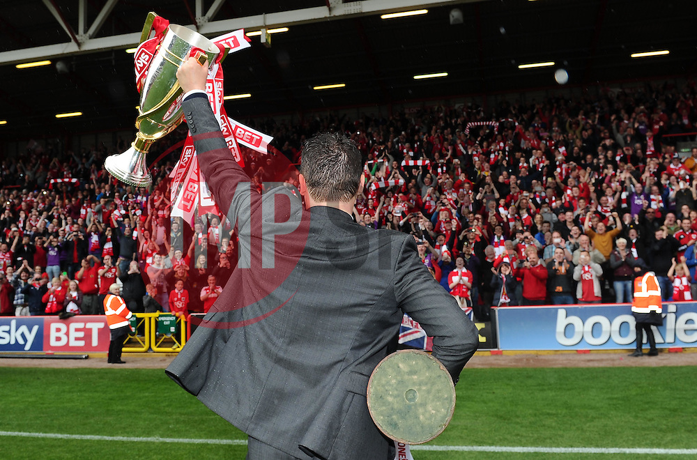 Bristol City manager, Steve Cotterill lifts the Sky Bet League One and JPT trophy's  - Photo mandatory by-line: Joe Meredith/JMP - Mobile: 07966 386802 - 03/05/2015 - SPORT - Football - Bristol - Ashton Gate - Bristol City v Walsall - Sky Bet League One