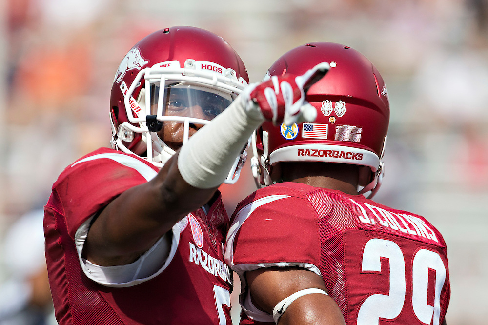 FAYETTEVILLE, AR - SEPTEMBER 5:  Henre' Toliver #5 and Jared Collins #29 of the Arkansas Razorbacks celebrate together during a game against the UTEP Miners at Razorback Stadium on September 5, 2015 in Fayetteville, Arkansas.  The Razorbacks defeated the Miners 48-13.  (Photo by Wesley Hitt/Getty Images) *** Local Caption *** Henre' Toliver; Jared Collins