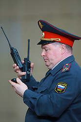 MOSCOW, RUSSIA - Wednesday, May 21, 2008: A Russian army officer with two radios and a telephone during the UEFA Champions League Final at the Luzhniki Stadium. (Photo by David Rawcliffe/Propaganda)