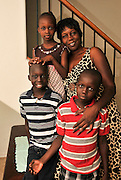 Nyibol Ngang, fled violence and war in Sudan and came to Tucson, Arizona, USA, via Egypt, as a refugee. She poses with three of her five children for a photo, Kuel Lual, 7, (red shirt), Lual Lual, 9, (black striped shirt), and Ajoung Lual, 5. They live with their husband and father and twin siblings in midtown.
