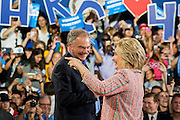 Hillary Clinton, presumptive 2016 Democratic presidential nominee, arrives with Senator Tim Kaine (D-VA) to campaign at Northern Virginia Community College in Annandale, Va., U.S., on Thursday, July 14, 2016. Clinton and the former Virginia Governor discussed their shared commitment to building an America that is stronger together, while emphasizing that Donald Trump's divisive agenda would be dangerous for America. Kaine is considered to be the frontrunner for the Vice Presidential slot. Photographer: Pete Marovich/Bloomberg