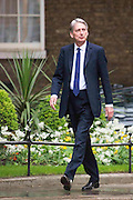 Photographer: Rick Findler<br /> <br /> London UK. 08.05.15 Philip Hammond MP walks into 10 Downing Street to meet with the Prime Minister David Cameron. Cameron appeared triumphant today as he was the doctor in becoming the new Prime Minster in the 2015 general election.