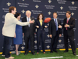 04 October 2011. New Orleans, Louisiana, USA.  <br /> NFL's New Orleans Saints announce a multi million dollar deal with Mercedes-Benz for naming rights on the Louisiana Superdome. Now the Mercedes-Benz Superdome. L/R Quarterback Drew Brees, Gayle Benson (wife of Tom), Saints owner Tom Benson, grand daughter, part owner and Saints VP Rita Benson Leblanc, Mercedes-Benz VP Marketing Stephen Cannon, Mercedes-Benz USA President and CEO Ernst Leib (catching ball). <br /> Photos; Charlie Varley/varleypix.com