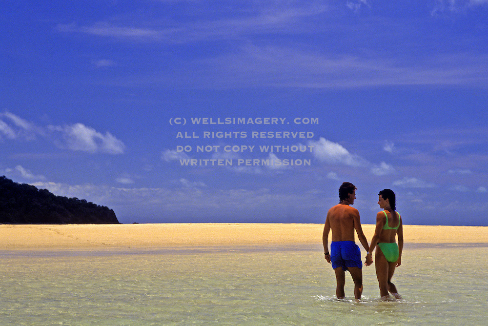 Image of a couple at the beach on Brampton Island offshore from Mackay in Queensland, Australia