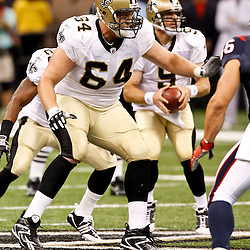 August 21, 2010; New Orleans, LA, USA; New Orleans Saints offensive tackle Zach Strief (64) blocks during the first quarter of a preseason game against the Houston Texans at the Louisiana Superdome. Mandatory Credit: Derick E. Hingle