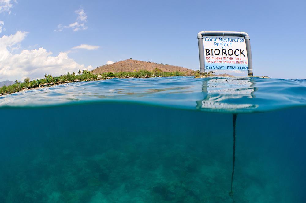 Sign declaring the Pemuteran Biorock Coral Restoration Area as a no-fishing area, Pemuteran, Bali, Indonesia.
