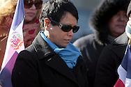Desafiando una temperatura de 13F, Ana Medina, presidente de Casa Dominicana, medita durante el acto en conmemoracion del Bicentenario de Juan Pablo Duarte, padre de la patria dominicana- 1813 2013. Los dominicanos acuadieron en gran número.