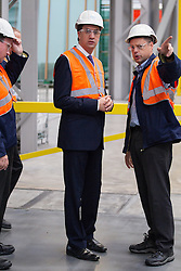 © Licensed to London News Pictures . 04/10/2013 . St Helens , UK . ED MILIBAND , the leader of the Labour Party , tours Pilkington Glass ' Cowley Hill Works in St Helens this morning (Friday 4th October 2013) . The production line builds energy efficient glazing . The opposition leader is currently embroiled in a row with the Daily Mail after it published a story stating that his father , Ralph Miliband , hated Great Britain . Photo credit : Joel Goodman/LNP