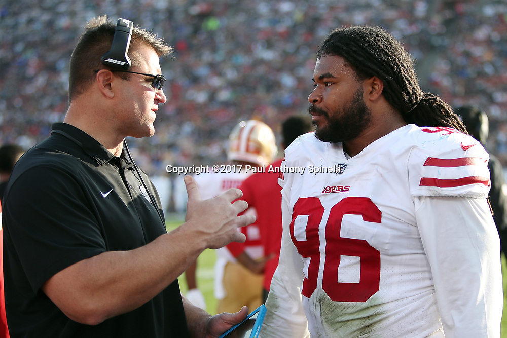 San Francisco 49ers defensive tackle Sheldon Day (96) talks to a coach on the sideline during the 2017 NFL week 17 regular season football game against the Los Angeles Rams, Sunday, Dec. 31, 2017 in Los Angeles. The 49ers won the game 34-13. (©Paul Anthony Spinelli)