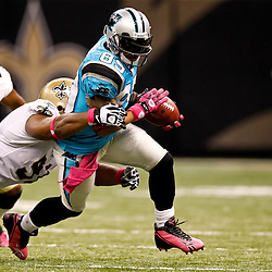 October 3, 2010; New Orleans, LA, USA; Carolina Panthers wide receiver Steve Smith (89) runs from New Orleans Saints defensive end Will Smith (91) during the second half at the Louisiana Superdome. The Saints defeated the Panthers 16-14. Mandatory Credit: Derick E. Hingle