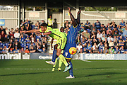 Hartlepool United midfielder Connor Smith feels the strength of Bayo Akinfenwa of AFC Wimbledon during the Sky Bet League 2 match between AFC Wimbledon and Hartlepool United at the Cherry Red Records Stadium, Kingston, England on 31 October 2015. Photo by Stuart Butcher.
