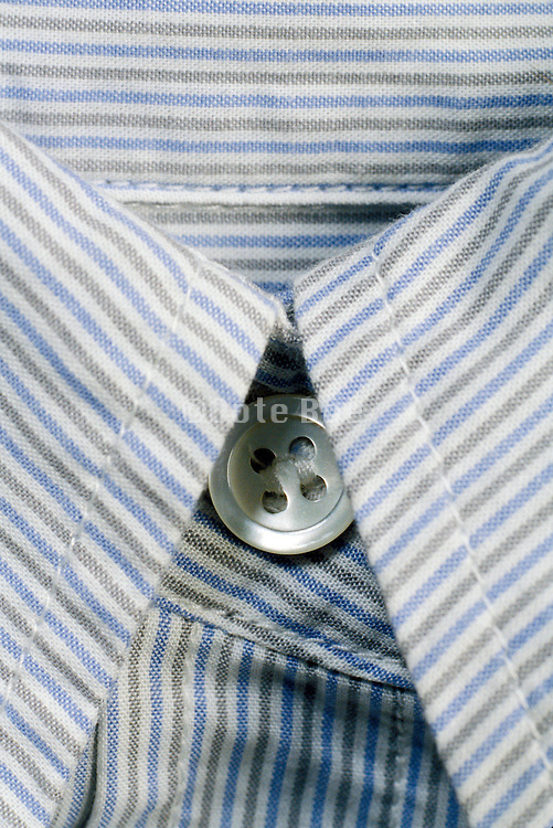 close up of a striped shirts collar