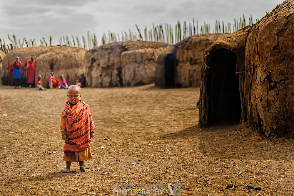 a small kid in a masai village near the entrance of ngorongoro crater, tanzania