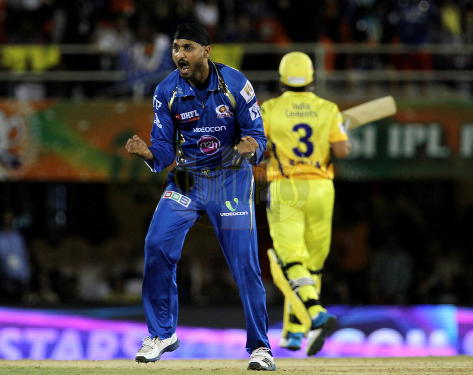 Harbhajan Singh of the Mumbai Indians celebrates the wicket of Faf du Plessis of The Chennai Superkings during the eliminator match of the Pepsi Indian Premier League Season 2014 between the Chennai Superkings and the Mumbai Indians held at the Brabourne Stadium, Mumbai, India on the 28th May  2014<br /> <br /> Photo by Vipin Pawar / IPL / SPORTZPICS<br /> <br /> <br /> <br /> Image use subject to terms and conditions which can be found here:  http://sportzpics.photoshelter.com/gallery/Pepsi-IPL-Image-terms-and-conditions/G00004VW1IVJ.gB0/C0000TScjhBM6ikg