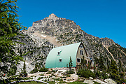 Eastpost Spire (8848 ft) rises behind Conrad Kain Hut in Bugaboo Provincial Park, in the Purcell Range of the Columbia Mountains, British Columbia, Canada.
