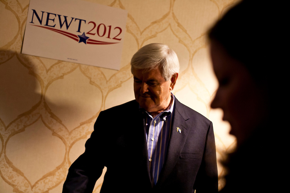 Republican presidential candidate Newt Gingrich and his wife Callista Gingrich pose for pictures at Junction Sports Bar & Grill on Sunday, January 1, 2012 in Marshalltown, IA.