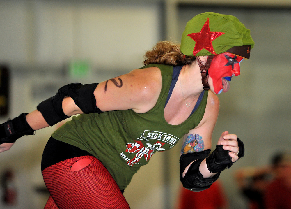 The Sis-Q Rollerz, of Medford, Take on the Sick Town Derby Dames' Dis-Orderlies in Albany on July 9, 2011.  (photo by Casey Campbell)