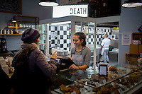 """Milan, Italy- December 5, 2014: Behind the counter at Pavé, a cafe and pasticceria where the motto is """"Bread or Death."""" CREDIT: Chris Carmichael for The New York Times"""