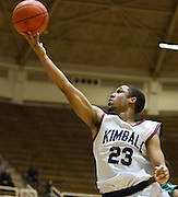 Jordan Adams (23) of Kimball drives to the basket against Carrollton Newman Smith in the Class 4A area-round playoff game Friday, February 22, 2013 at the Alfred J. Loos Field House in Addison, Texas. (Cooper Neill/The Dallas Morning News)