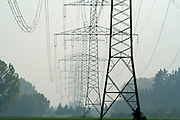 electric pylon silhouettes disappearing into the distance