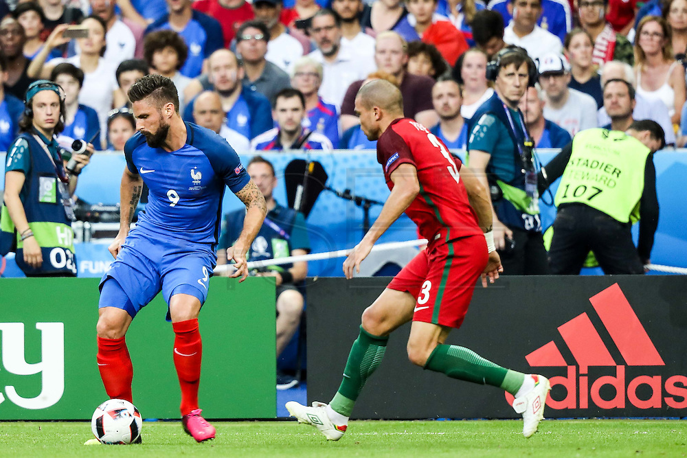 Gird from France and Pepe from Portugal during the match against France. Portugal won the Euro Cup beating in the final home team France at Saint Denis stadium in Paris, after winning on extra-time by 1-0.