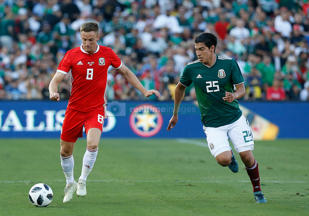 May 28, 2018 - Pasadena, CA, U.S. - PASADENA, CA - MAY 28: Andy King of Wales makes a pass by Erick GutiŽrrez of Mexico during the game on May 28, 2018, at the Rose Bowl in Pasadena, CA.  (Photo by Adam  Davis/Icon Sportswire) (Credit Image: © Adam Davis/Icon SMI via ZUMA Press)