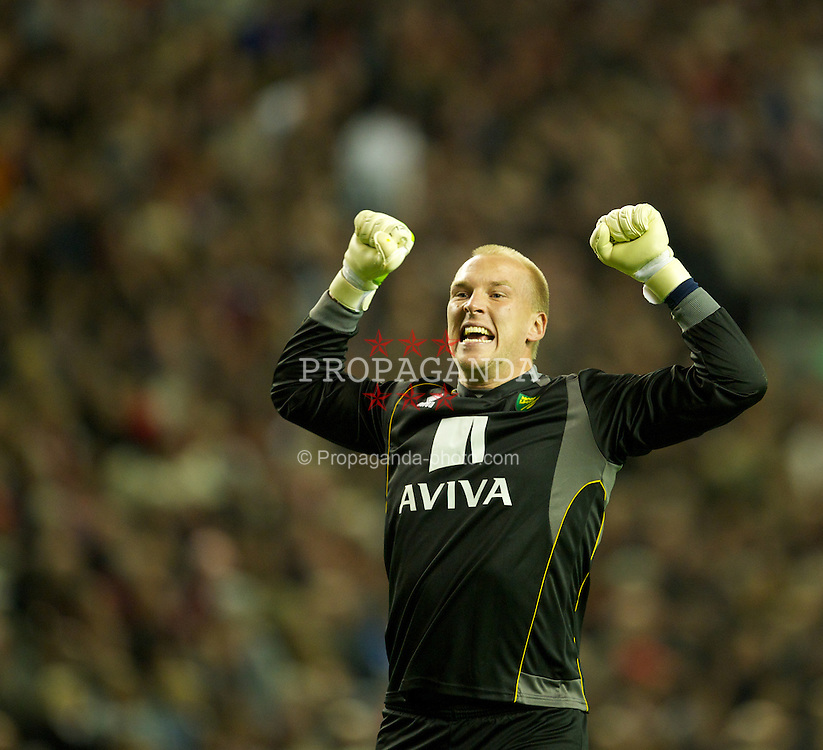 LIVERPOOL, ENGLAND - Saturday, October 22, 2011: Norwich City's goalkeeper John Ruddy celebrates his side's equalising 1-1 goal against Liverpool during the Premiership match at Anfield. (Pic by David Rawcliffe/Propaganda)