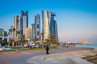 DOHA, QATAR - CIRCA DECEMBER 2013: View of the Al Corniche Promenade and street with skyline in Doha