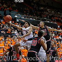 Oregon State's Stephen Thompson Jr. (2) drives past Utah's Dakaria Tucker (14), Chris Reyes (20) and Lorenzo Bonam, right, in the first half of an NCAA college basketball game in Corvallis, Ore., on Thursday, Feb. 4, 2016. (AP Photo/Timothy J. Gonzalez)