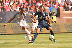 July 28, 2018 - Ann Arbor, MI, U.S. - ANN ARBOR, MI - JULY 28: Liverpool Defender Fabinho (3) passes the ball while pressured by Manchester United Forward Juan Mata (8) in the ICC soccer match between Manchester United FC and Liverpool FC on July 28, 2018 at Michigan Stadium in Ann Arbor, MI. (Photo by Allan Dranberg/Icon Sportswire) (Credit Image: © Allan Dranberg/Icon SMI via ZUMA Press)