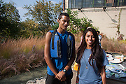 "Hunts Point, Bronx, New York - Jasmine Benitez and Kenny Glass, both 20, work for youth empowerment group Rocking the Boat. They say the group has helped them get into college and be motivated about improving the environment. Benitez, who has spent four years with the organization, is from the Kingsbridge neighorhood of the Bronx. Glass, who has been with the group for five years and ""fell in love with the environment,"" is from Hunts Point. Both attended Reverend Billy Talen's performance in Hunts Point, the Bronx, New York on Saturday, October 5, 2013."