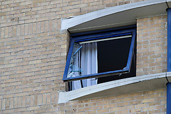 © Licensed to London News Pictures. 05/07/2020. London, UK. A broken window is seen on the sixth floor of the Holiday Inn on Bugsby's Way in Greenwich. Police were called to the Holiday Inn at 10:02hrs this morning to a report of a woman stabbed. Police Officers and London Ambulance Service attended and a woman was found suffering serious injuries and was declared dead at the scene. While attending the incident, a man believed to be known to the woman, fell from height. He was taken to hospital, where he remains under the guard of officers. His condition is being treated as life-threatening. Photo credit: George Cracknell Wright/LNP