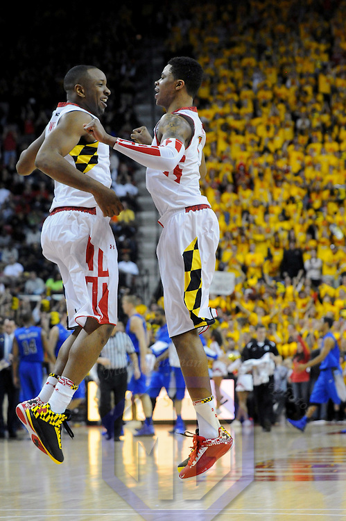 16 February 2013:   Maryland Terrapins guard/forward Dez Wells (32) leaps in the air with guard Nick Faust (5) in action against the Duke Blue Devils at the Comcast Center in College Park, MD. where the Maryland Terrapins upset the second ranked Duke Blue Devils, 83-81.