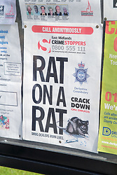Police sign; Rat on a rat; asking members of the public to help them track down drug dealers,