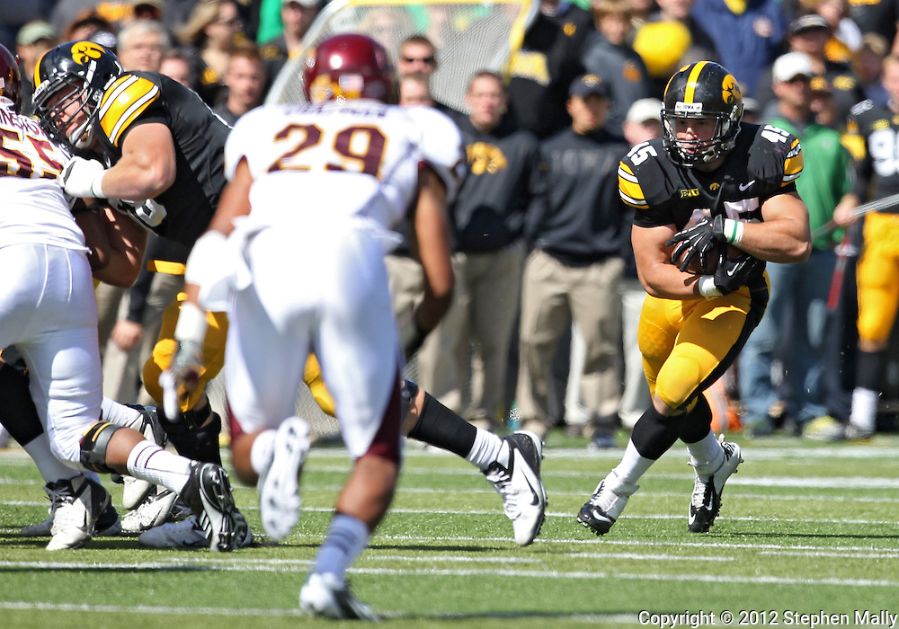 September 22 2012: Iowa Hawkeyes fullback Mark Weisman (45) protects the ball as he runs during the second half of the NCAA football game between the Central Michigan Chippewas and the Iowa Hawkeyes at Kinnick Stadium in Iowa City, Iowa on Saturday September 22, 2012. Central Michigan defeated Iowa 32-31.