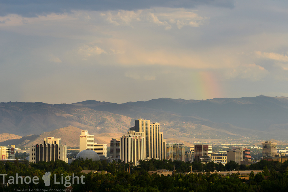 Reno, Nevada, downtown city skyline with casinos and mountains and rainbow
