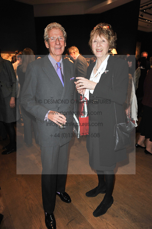 CHRISTOPHER BALFOUR and PENNY GRAHAM at a party to celebrate the publication of The irish Country House written by The Knight of Glin and James Peill with photographs by James Fennell, held at Christie's, King Street, London on 24th January 2011.