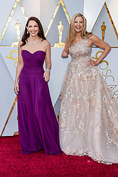 Ashley Judd and Mira Sorvino walking on the red carpet during the 90th Academy Awards ceremony, presented by the Academy of Motion Picture Arts and Sciences, held at the Dolby Theatre in Hollywood, California on March 4, 2018. (Photo by Anthony Behar/Sipa USA)